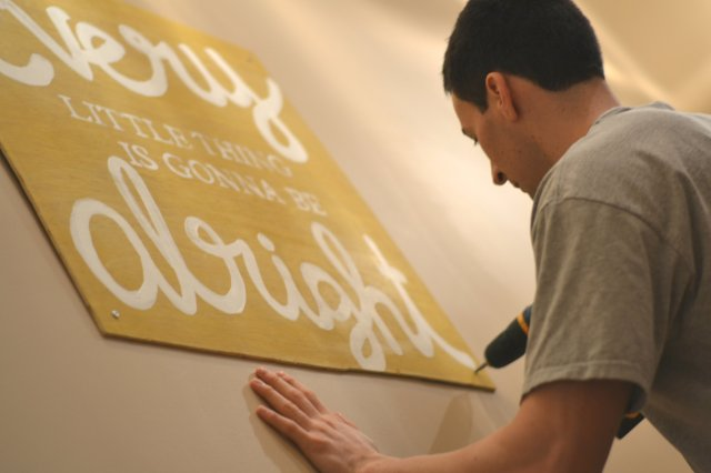 "Week 3:  ""8 o'clock""Hanging up our new artwork last night!"